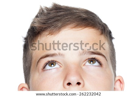 Closeup of teenager boy looking up, isolated on white - stock photo