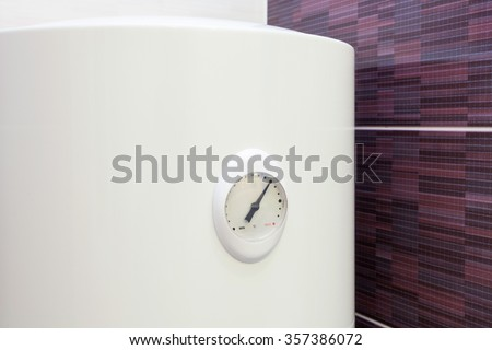Closeup of temperature sensor in Electric Boiler (wall water heater) - stock photo
