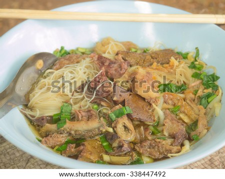 Closeup of Thai local style stewed pork rice noodle - stock photo