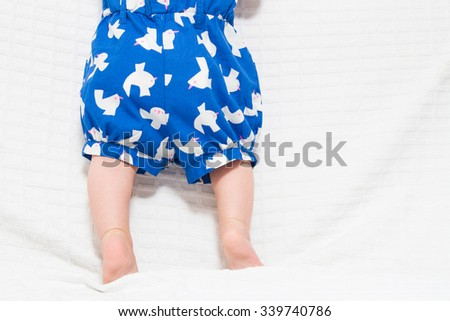 Closeup of the adorable small legs of baby on white background - stock photo