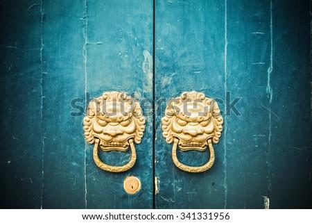 closeup of the antique oriental door knocker - stock photo