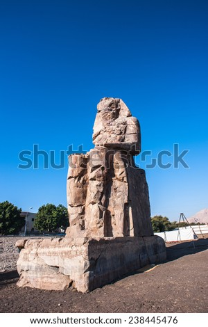 Closeup of the Colossus of Memnon, massive stone statue of Pharaoh Amenhotep III, Luxor, Egypt - stock photo