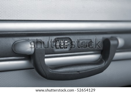 Closeup of the combination Lock of a suitcase - stock photo