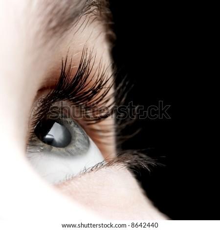 Closeup of the eye of a girl - stock photo