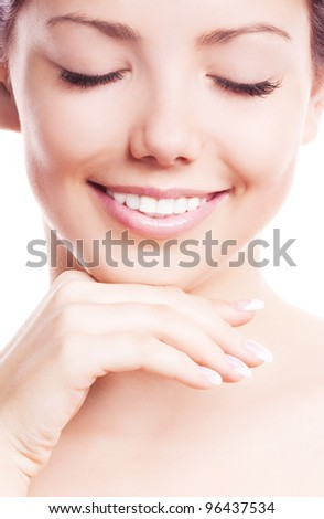 closeup of the face, hands and healthy white teeth of a woman, isolated on white background