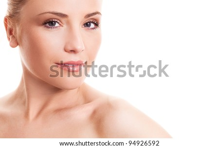 closeup of the face of a beautiful young woman with healthy skin and natural makeup, isolated against white background, copyspace for the text to the right - stock photo
