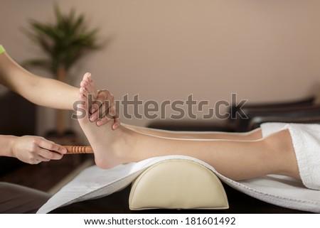 Closeup of the foot massage - stock photo