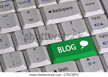 Closeup of the grey textured keys of a modern laptop computer keyboard.  One green colored key is labeled BLOG and includes a thought bubble symbol. - stock photo