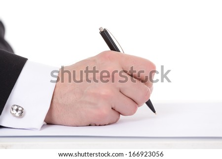 Closeup of the hands of a businessman taking notes holding a pen over a blank sheet of paper as he prepares to begin writing