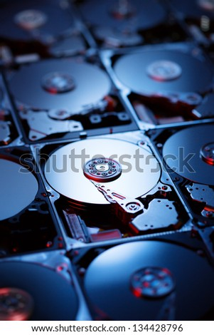 Closeup of the inside of harddrives - stock photo