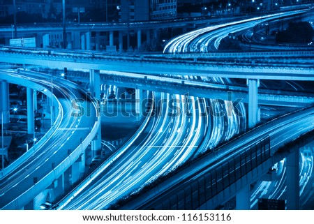 closeup of the light trails on highway viaduct - stock photo