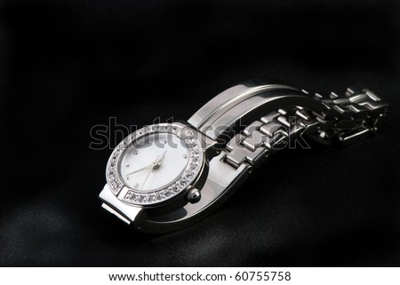 closeup of the  luxurious lady's  watch - stock photo