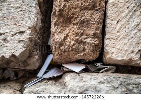 Closeup of the messages in the Western Wall, Jerusalem - stock photo