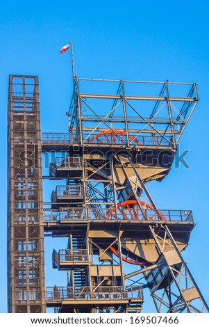 Closeup of the mine shaft with the Polish national flag on the top, in Katowice, Poland. - stock photo