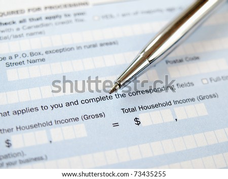 Closeup of  the pen on the application form