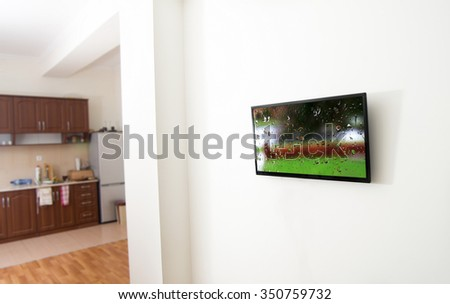 closeup of the tv screen in apartment with picture
