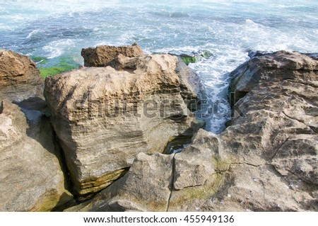 Closeup of the unique limestone on the coast at Penguin Island with Indian Ocean waters in Rockingham, Western Australia/Limestone and Indian Ocean Waters/Penguin Island, Rockingham, Western Australia