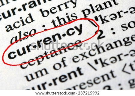 Closeup of the word currency in the English dictionary