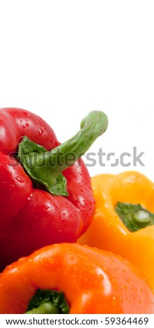 closeup of three bell peppers on white (focus on red pepper) with copy space - stock photo