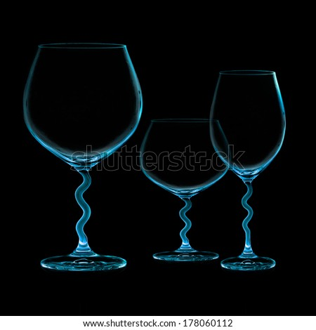 Closeup of three empty cups isolated on black. Balloon glass for red wine. Cup for white wine. Brandy glass - stock photo