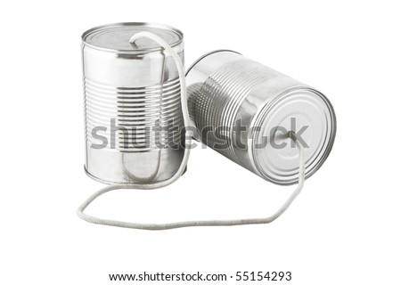 Closeup of tin cans telephone connected by string on white background, business communication concept - stock photo