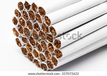 Closeup of tobacco cigarettes on white background. - stock photo