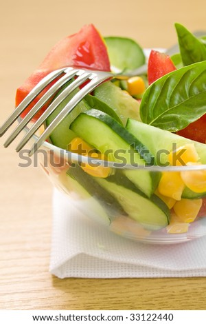 Closeup of tomato and corn salad on the table