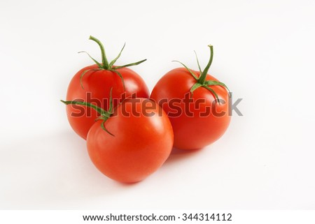 Closeup of tomatoes on a white background  - stock photo