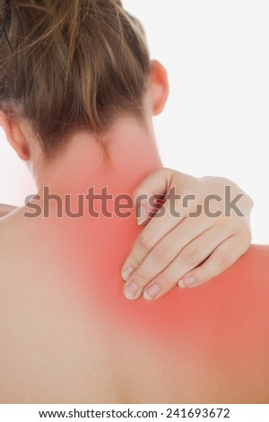 Closeup of topless woman massaging back over white background - stock photo