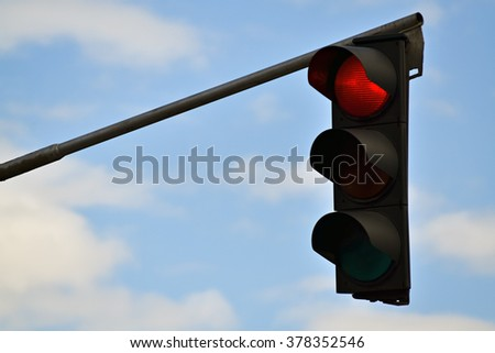 Closeup of traffic light and cloudy sky in the background - stock photo