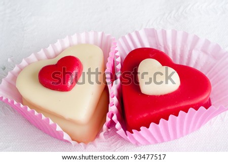 closeup of two delicious valentine cakes