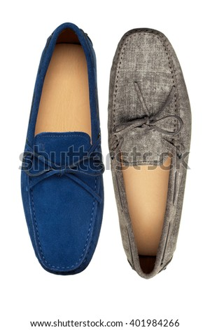 Closeup of two different loafer shoes on white background - stock photo