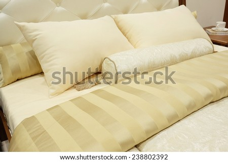 closeup of two pillows and bolster - stock photo