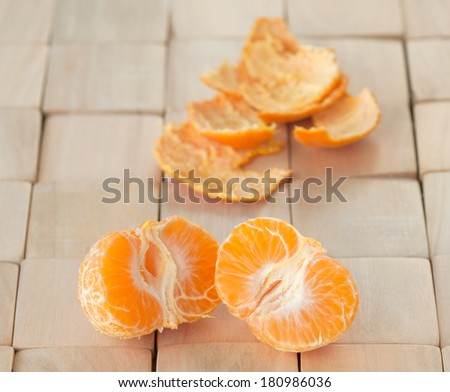 Closeup of Two Refreshing, Juicy Tangerines Fresh from Tree on a wooden contemporary, modern place mat, a winter crop grown in California.  Background room or space for copy, text, words.   - stock photo
