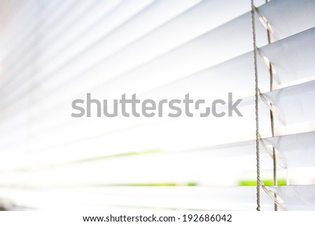 Closeup of two shutters at an business office - stock photo