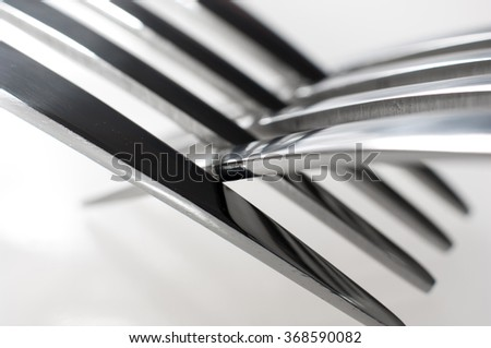 Closeup of two silver forks.