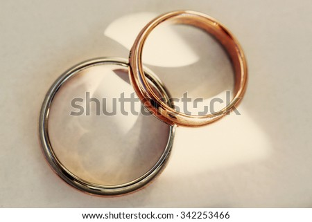 Closeup of two stylish expensive gold and silver wedding rings