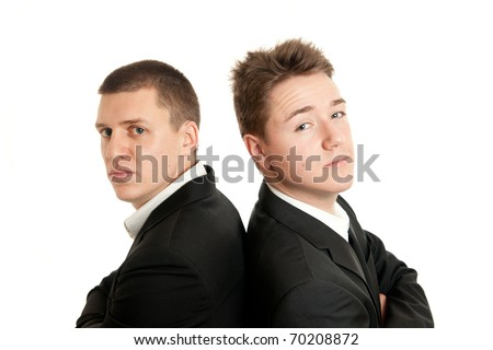 closeup of two young businessmen standing back on back