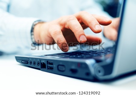 Closeup of typing male hands - stock photo