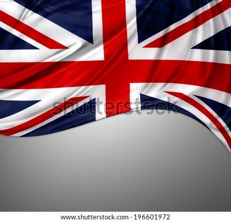 Closeup of Union Jack flag on grey background - stock photo