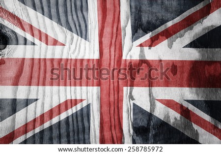Closeup of Union Jack flag on wood - stock photo
