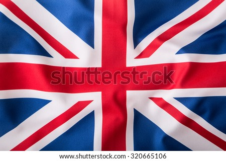 Closeup of Union Jack flag. UK Flag. British Union Jack flag blowing in the wind.  - stock photo