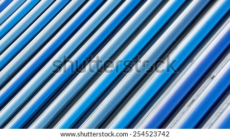 Closeup of vacuum tubes from solar water heating system. - stock photo