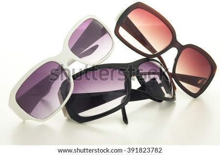 Closeup of various sunglasses isolated over white background