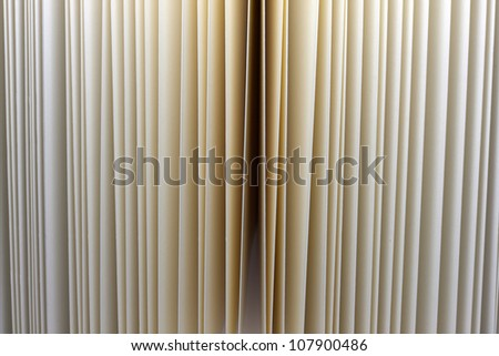 Closeup of vintage open book paper sheets texture background - stock photo