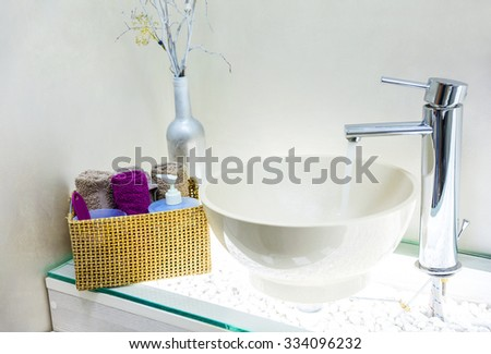 Closeup of wash basin in modern bathroom interior - stock photo