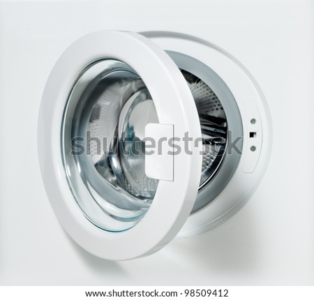 closeup of washing machine door with empty drum - stock photo