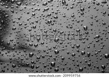 Closeup of water droplets on black background - stock photo