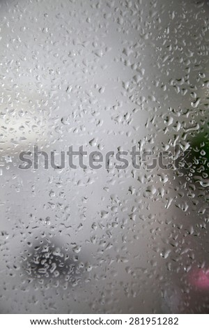 Closeup of water droplets on glass - stock photo