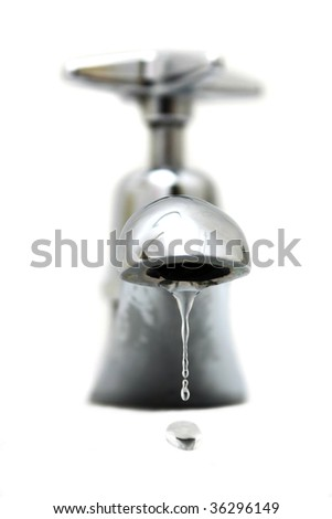 Closeup of water dropping from silver faucet.
